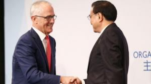 象征主义:总理马尔科姆·特恩布尔和李总理团结一致反对贸易保护主义。 图文:布伦登·索恩